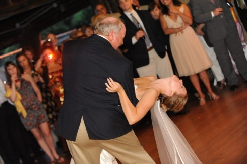 The bride gets a dip from her father...